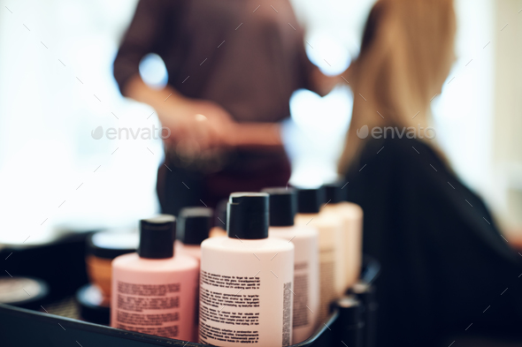 Bottles of styling products in a hair salon - Stock Photo - Images