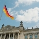Spring Blue Sky Over the Building of the Bundestag in Germany. German Flags Waving in the Wind - VideoHive Item for Sale