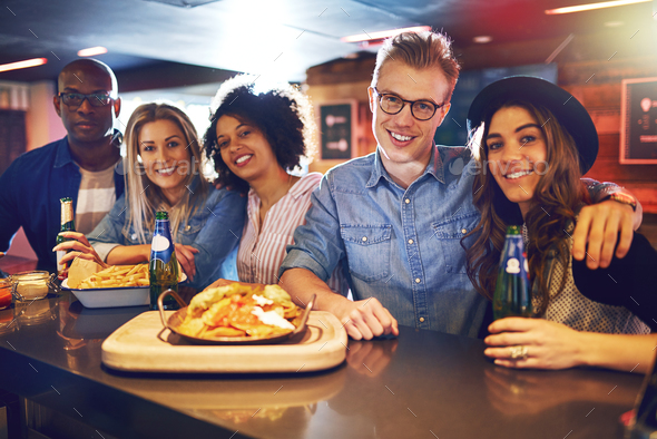 People having snacks and beer at bar - Stock Photo - Images