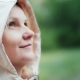 A Young Woman in a Pink Hood Rejoices in the Spring Rain - VideoHive Item for Sale