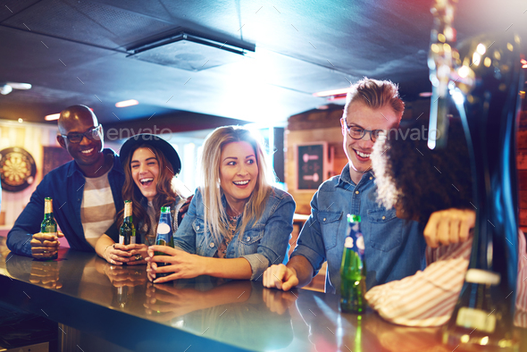 Group of happy people at bar counter - Stock Photo - Images