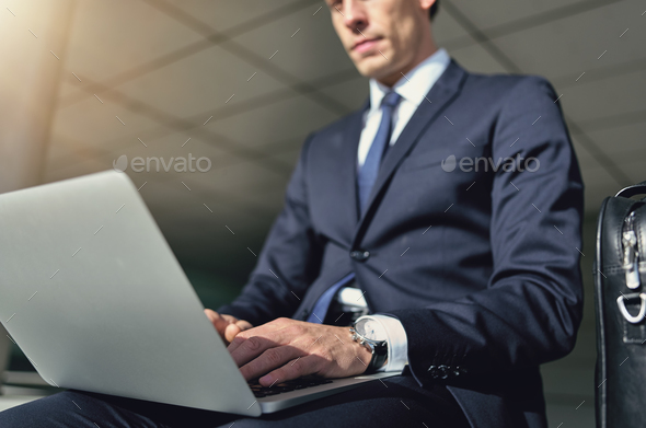 Confident businessman works with his gray notebook - Stock Photo - Images