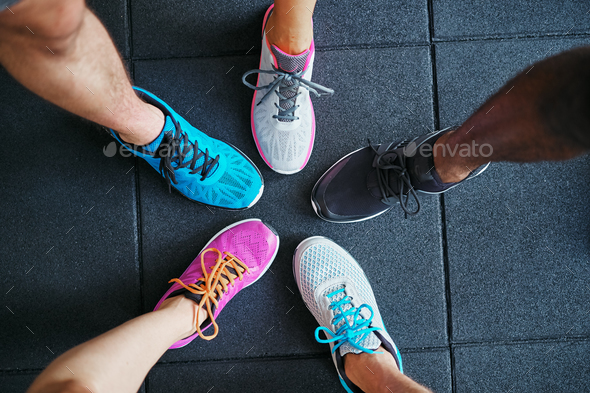 Closeup of feet in running shoes standing in a gym - Stock Photo - Images