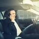 Smiling businessman talking on a phone in his car - PhotoDune Item for Sale
