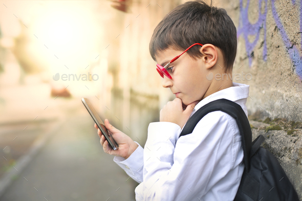 Child with a smartphone - Stock Photo - Images
