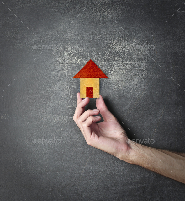 Hand holding a tiny house - Stock Photo - Images