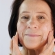 Smiling Woman Applying Cream - VideoHive Item for Sale