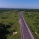 Aerial View Above Cars Driving Along Empty Countryside Road on Sunny Day - VideoHive Item for Sale