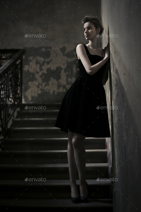 Elegant woman on stairs - Stock Photo - Images