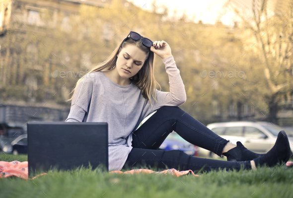 Girl with a laptop outdoor - Stock Photo - Images