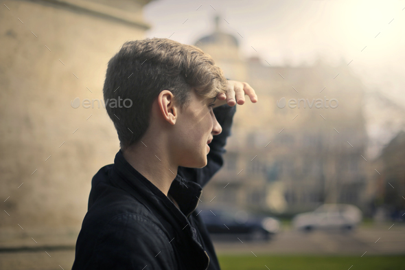 Guy looking in front of him - Stock Photo - Images