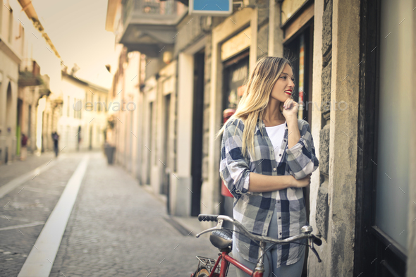 Girl in a downtown street - Stock Photo - Images