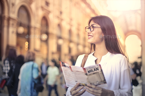 Girl with a city map - Stock Photo - Images