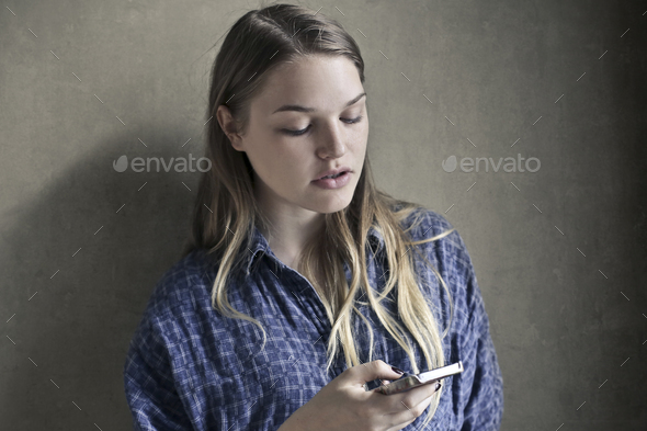 Girl with a smartphone - Stock Photo - Images