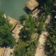 Bungalows and Boats Among Exotic Palms and Trees on River Bank Aerial  - VideoHive Item for Sale