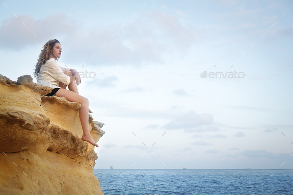 Girl looking at the sea - Stock Photo - Images
