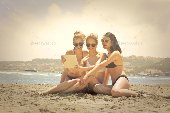 Three friends at the beach - Stock Photo - Images