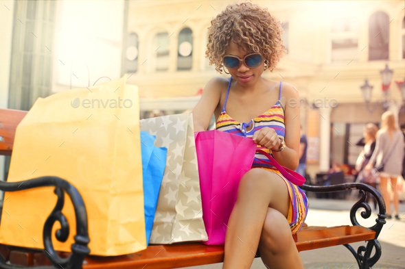 Girl with a lot of shopping bags - Stock Photo - Images