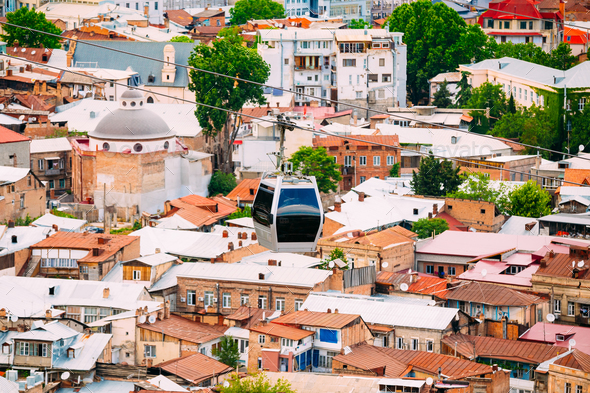 Modern New Cableway Ropeway Tinted Car Moving Under Old Resident - Stock Photo - Images