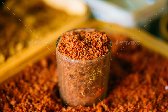 Close-Up Glass Of Red Ground Aromatic Spice Mixture With Salt Ad - Stock Photo - Images