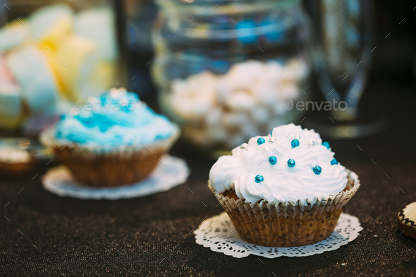 Dessert Sweet Tasty cupcake in Candy Bar On Table - Stock Photo - Images