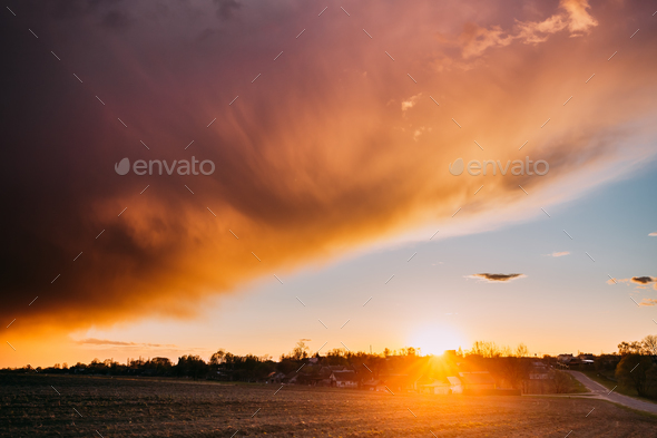 Spring Sunset Sunrise. Sun Above Village In Belarusian Countrysi - Stock Photo - Images
