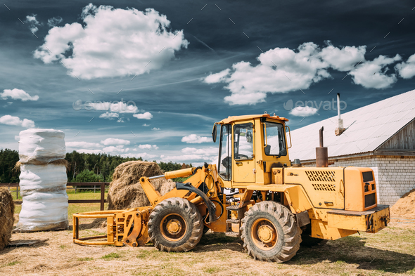 Multipurpose Wheel Loader Carry Out Works In Transportation Of H - Stock Photo - Images
