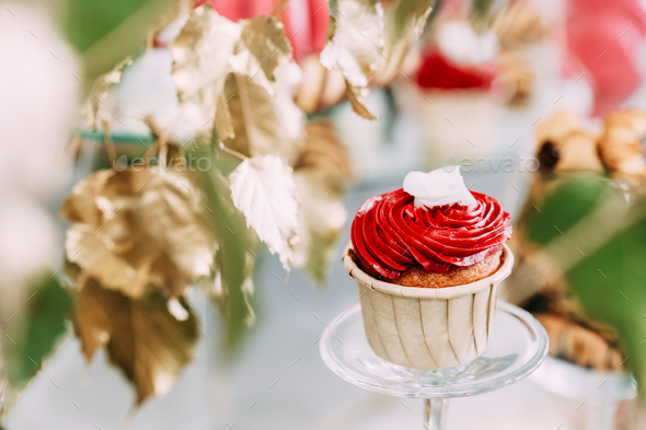 Dessert Sweet Tasty Cupcake In Candy Bar On Table. Delicious Swe - Stock Photo - Images