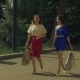 Happy Women with Shopping Bags Walking on the Street - VideoHive Item for Sale