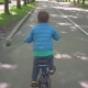 Little Boy Riding Blue Bicycle in the City Park - VideoHive Item for Sale