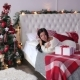 Portrait of a Sexy Girl with Christmas Gift on Bed - VideoHive Item for Sale
