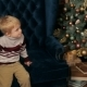 Boy Is Sitting on the Couch Near Christmas Tree. - VideoHive Item for Sale