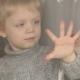 Little Boy Is Holding His Palm on Window, - VideoHive Item for Sale
