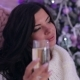 of Girl with Champagne Near Christmas Tree - VideoHive Item for Sale