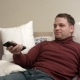 Man Lies in Bed Watches Television and Smiling - VideoHive Item for Sale