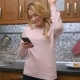 Happy Young Woman Dancing in Kitchen Listening To Music on Smartphone at Home - VideoHive Item for Sale