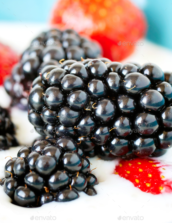 Blackberries and strawberries in yogurt. - Stock Photo - Images