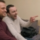 Two Male Friends on Sofa Watching Television and Laughing - VideoHive Item for Sale