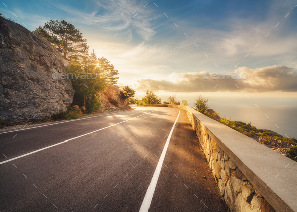 Mountain asphalt road at sunset in summer in Europe - Stock Photo - Images