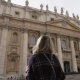 Woman in Sunglasses with a Smartphone in Her Hands Looks at at St. Peter's Basilica in Vatican - VideoHive Item for Sale