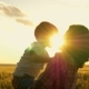 Mother and Child Embrace and Laugh at the Sunset - VideoHive Item for Sale