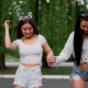 Two Sexy Young Girls Riding on Segway in Short Shorts Holding Hands and Laughing on a Sunny Day - VideoHive Item for Sale