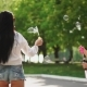 Two Beautiful Young Girls in Sexy Clothes Are Laughing and Dancing While Riding a Segway in the Park - VideoHive Item for Sale