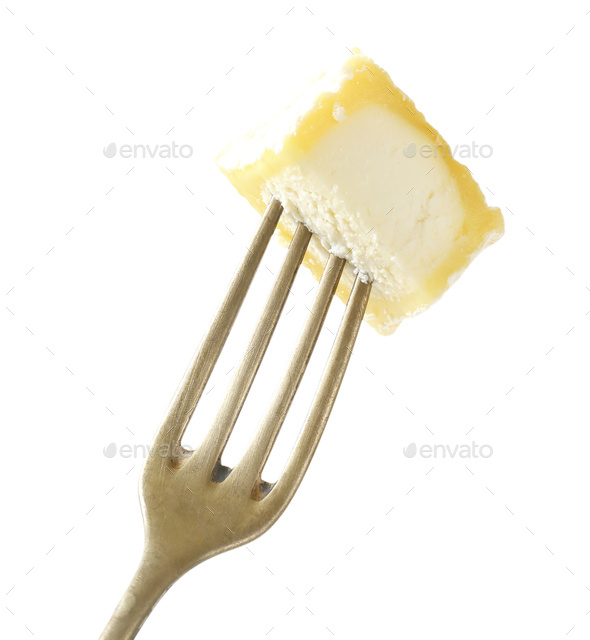 Piece of Chevre cheese on fork - Stock Photo - Images