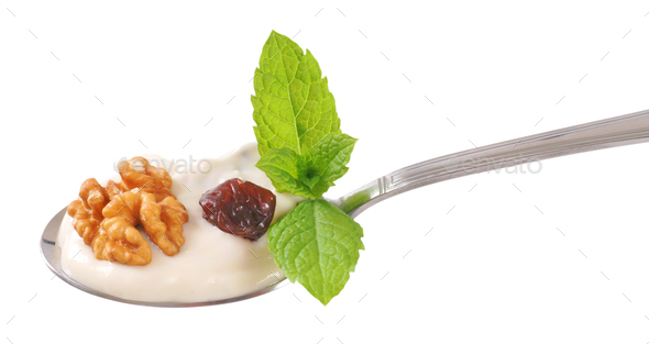 spoon of cream cheese with nuts and raisins - Stock Photo - Images
