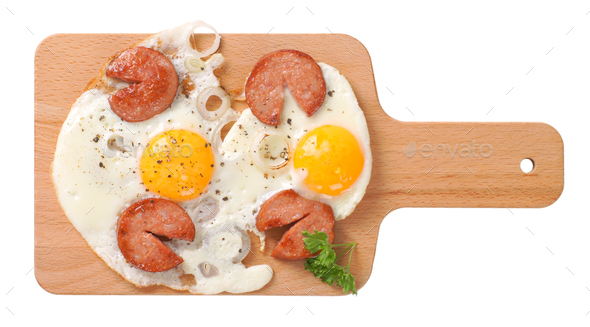 fried eggs with sausage - Stock Photo - Images