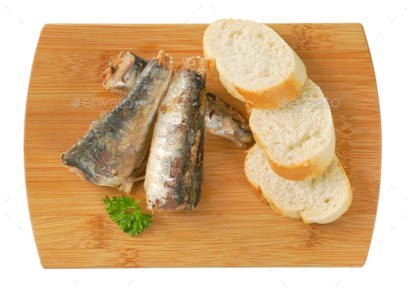 sardines with slices of bread - Stock Photo - Images