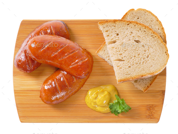 short thick sausages with bread - Stock Photo - Images