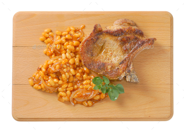 pork chop and baked beans - Stock Photo - Images