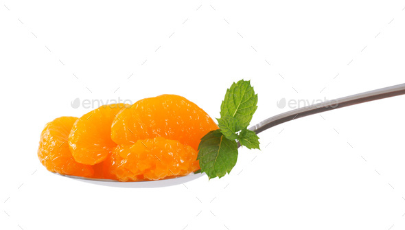 spoon of peeled tangerine segments - Stock Photo - Images